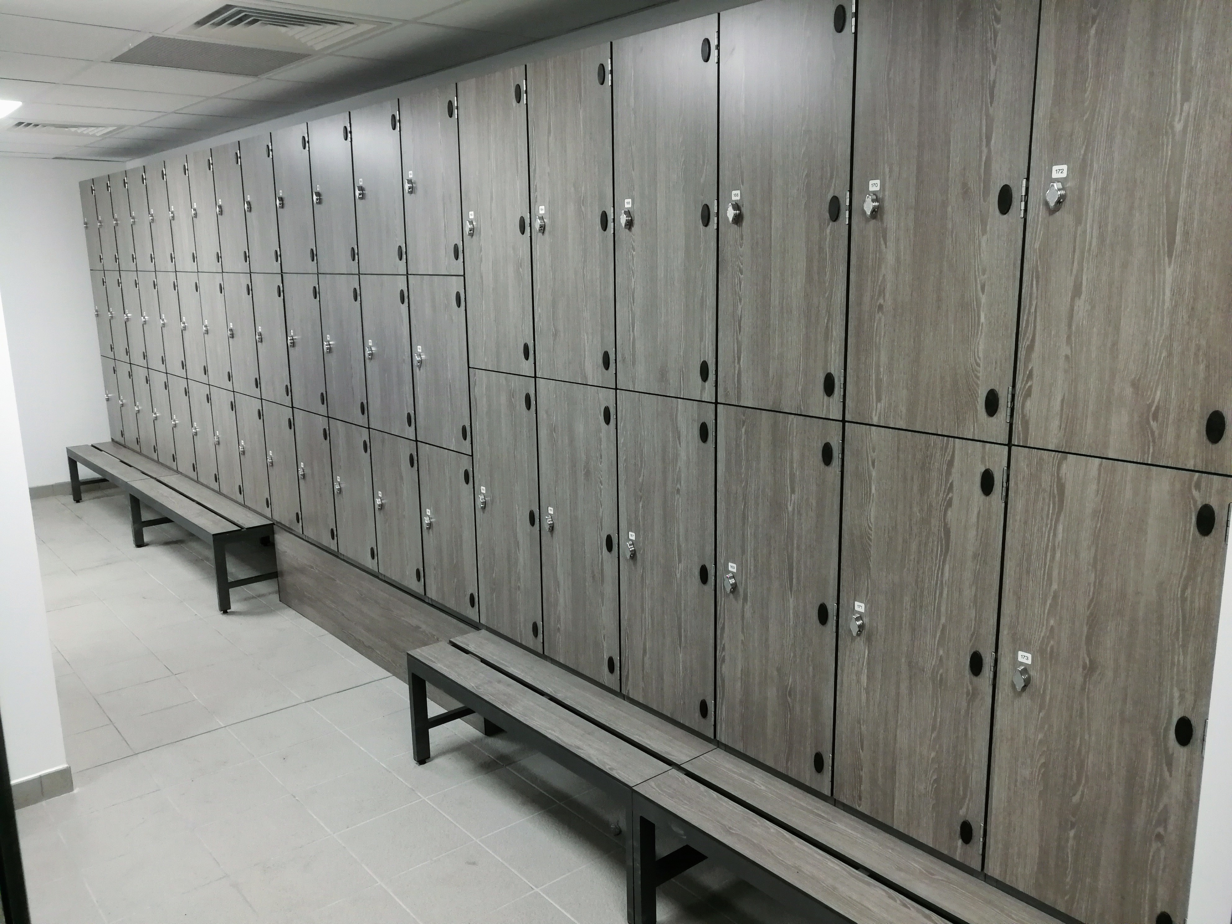 Locker room with wood benches and wooden lockers stock photo